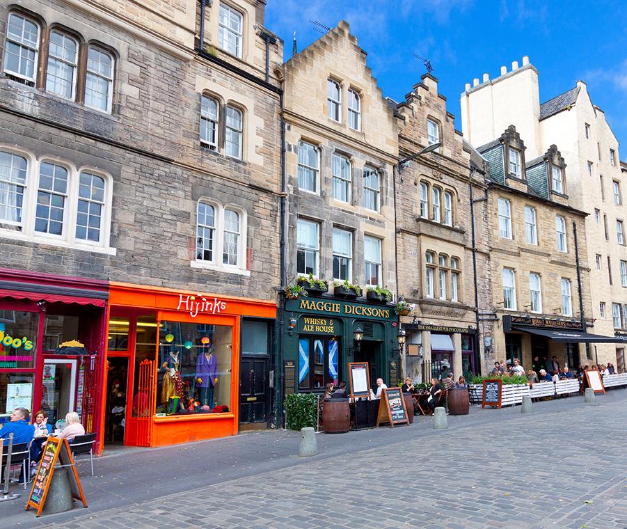 Greater Grassmarket lined with restaraunts and pubs, Edinburgh, United Kingdom.
