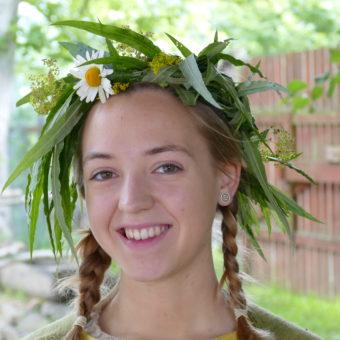A woman wearing a flower garland